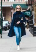 Emily Blunt embraces the spring weather as she enjoys a morning stroll in Tribeca, New York City