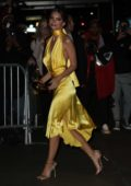 Emily Ratajkowski dazzles in a yellow silk dress as she arrives at Marc Jacobs wedding reception in New York City