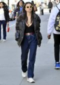 Emily Ratajkowski keeps it trendy with a plunging black top, puffer jacket while heading to a business meeting in New York City