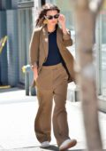 Emily Ratajkowski looks cool in an oversized brown pantsuit and white sneakers while out for a stroll in New York City