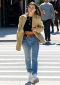 Emily Ratajkowski looks stylish in a black crop top paired with a blazer and jeans while out in New York City