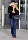 Emma Bunton is all smiles as she leaves the Virgin radio studios in London, UK
