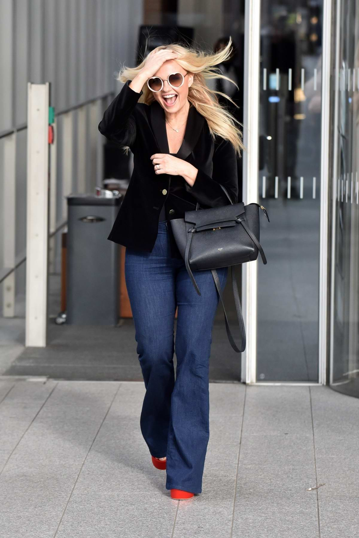 Emma Bunton is all smiles as she leaves the Virgin radio studios in London, UK