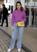 Emma Mackey spotted in a pink jumper and blue jeans outside the Hotel Martinez in Cannes, France