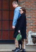 Emma Roberts and Garrett Hedlund are all smiles as she they step out together holding hands in New York City