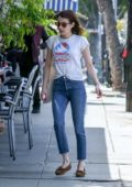 Emma Roberts keeps it simple with white tee and blue jeans while out running errands In Los Angeles