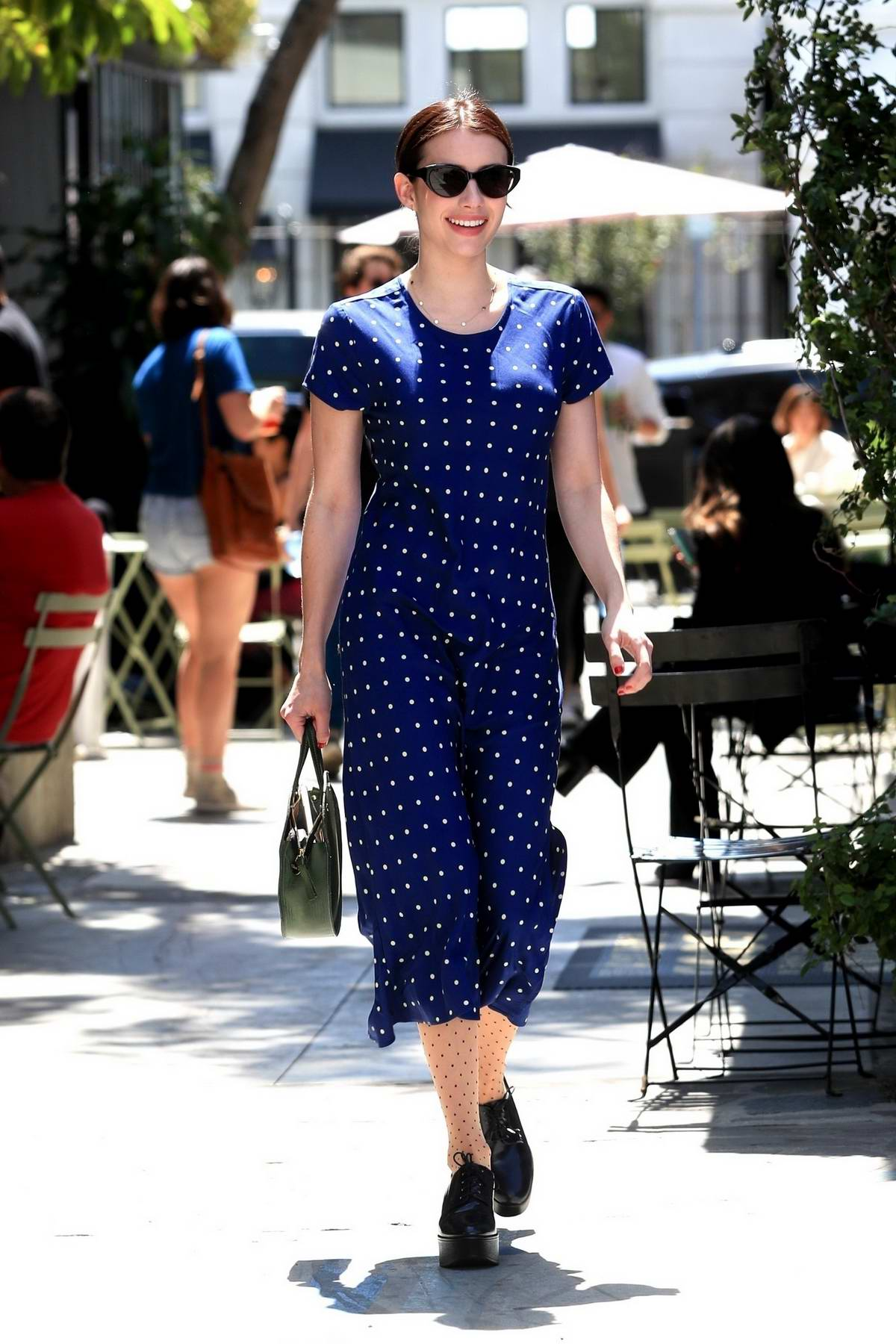 Emma Roberts radiates in a blue polka dot dress as she leaves Nine Zero One in West Hollywood, Los Angeles