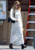 Emma Roberts steps out in a white maxi dress for some grocery shopping in Los Angeles