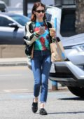 Emma Roberts wears a colorful tie-dye top as she steps out for coffee in Los Angeles