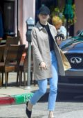 Emma Stone flashes her big engagement ring as she picks up her lunch to go in Los Angeles