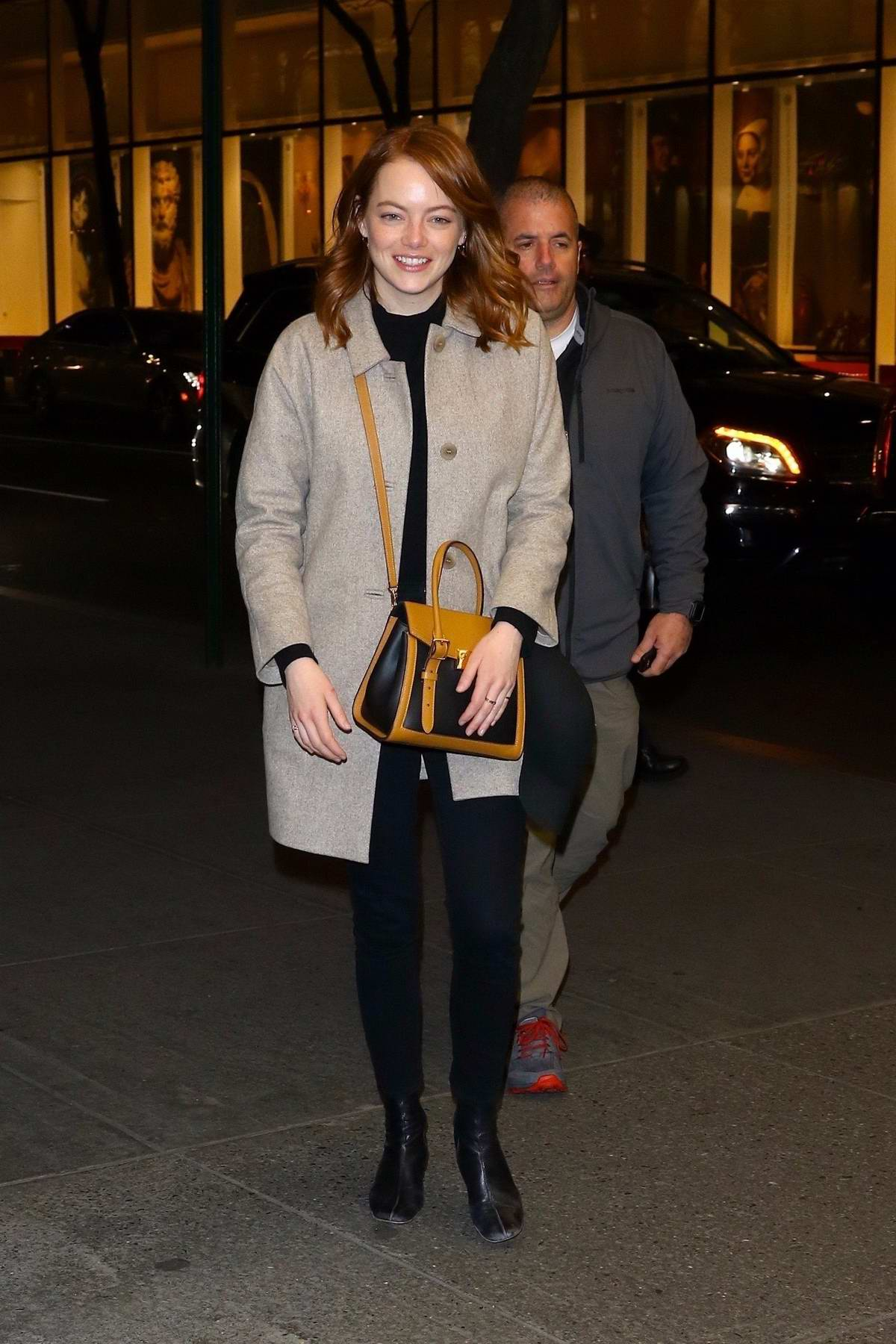 Emma Stone is all smile as she heads back to NBC Studios after dinner in New York City