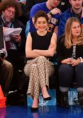 Emmy Rossum attends the Detroit Pistons v New York Knicks game at Madison Square Garden in New York City