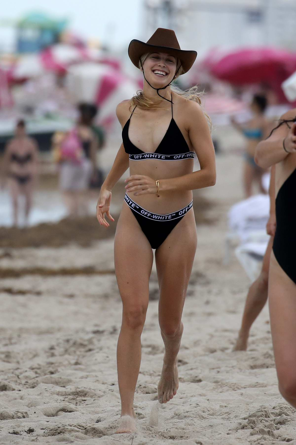 Eugenie Bouchard looks stunning in a black bikini and cowboy hat while enjoying the beach with friends in Miami, Florida