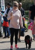 Gemma Atkinson enjoys an ice cream at a charity dog walk for Hits Radio in Heaton Park, Manchester, UK