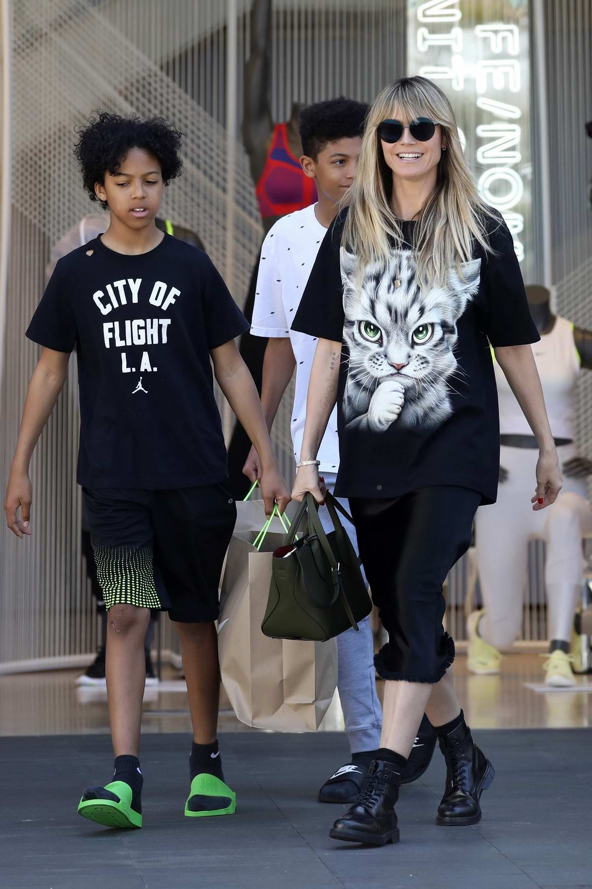 Heidi Klum shops at the Nike store with her two sons in Los Angeles