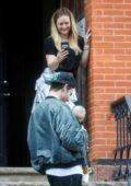 Hilary Duff takes pictures of Matthew Koma and their daughter in New York City