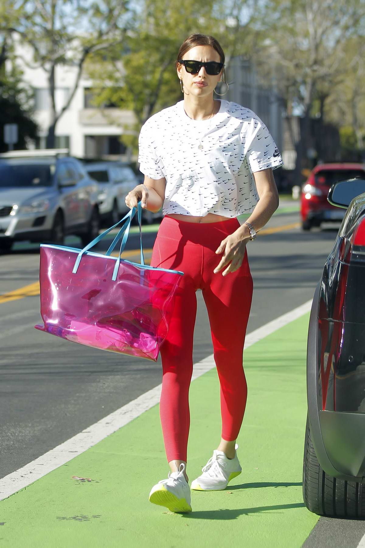 Irina Shayk rocks a Nike top and red leggings while visiting a massage parlor in Brentwood, Los Angeles
