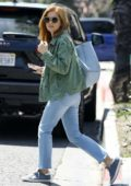 Isla Fisher sports double denim while out shopping with a friend on Melrose Place in Los Angeles