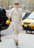 Jaime King looks stylish in a beige sweater and patchwork pants as she heads out in New York City