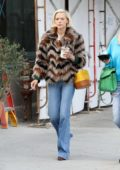 Jaime King seen wearing a fur coat and boot cut jeans while out shopping with a friend in Los Angeles
