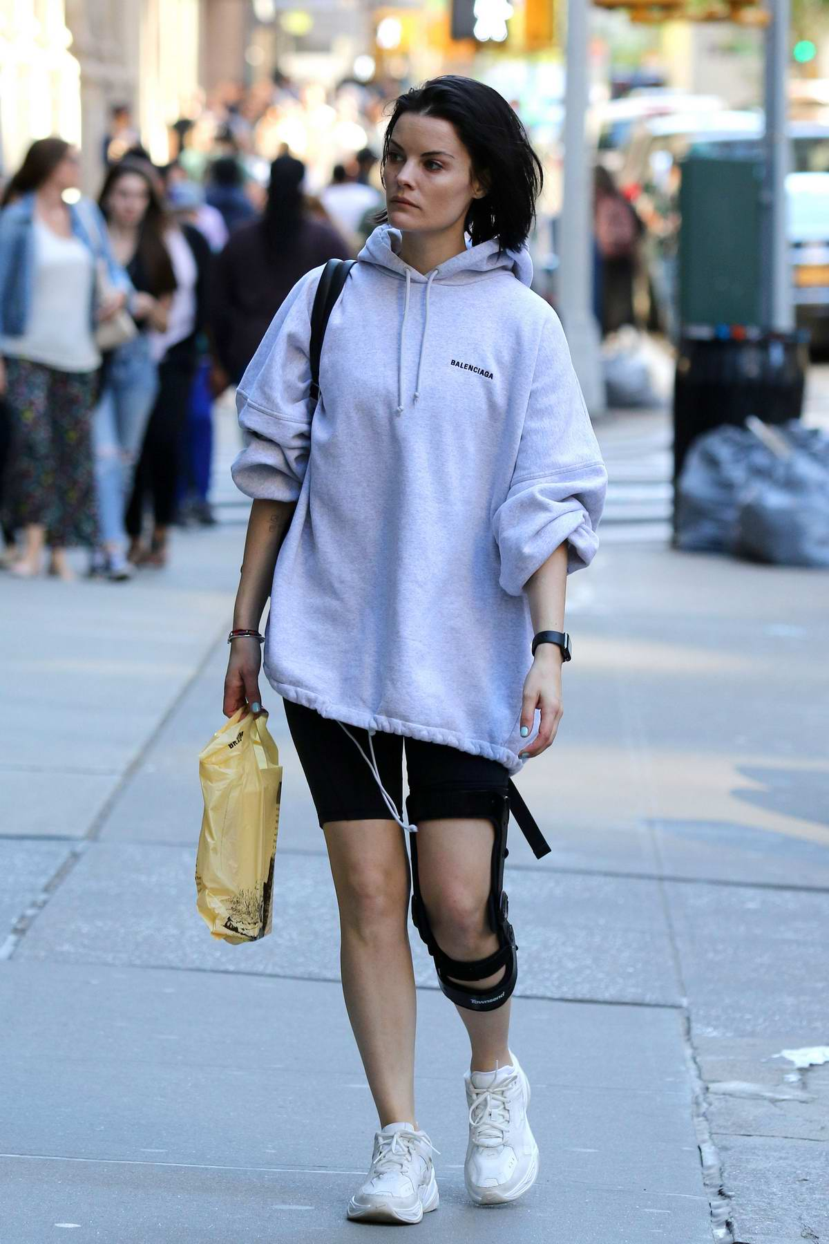 Jaimie Alexander rocks a Balenciaga hoodie and black shorts with a knee brace while out shopping for books in New York City