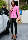 Jasmine Tookes looks striking in a pink blazer and black leather pants as she arrives at an event in Los Angeles