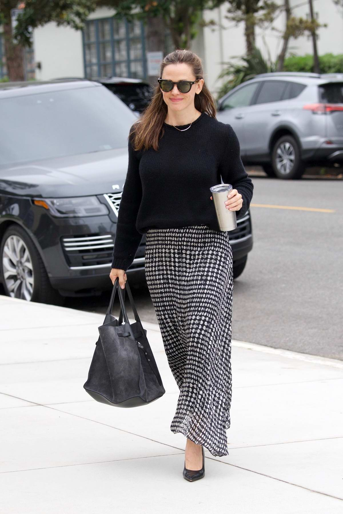 Jennifer Garner looks lovely in a monochrome ensemble as she arrives for the Sunday church service in Pacific Palisades, California