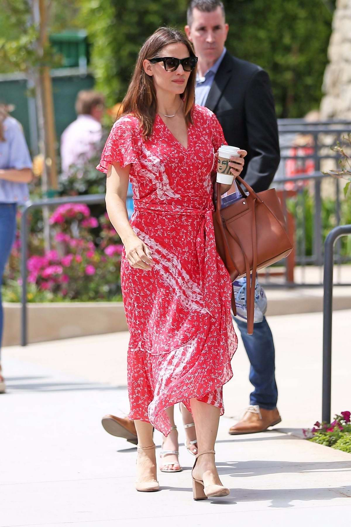 Jennifer Garner looks lovely in a patterned red dress as she attends the Easter Sunday church services in Los Angeles