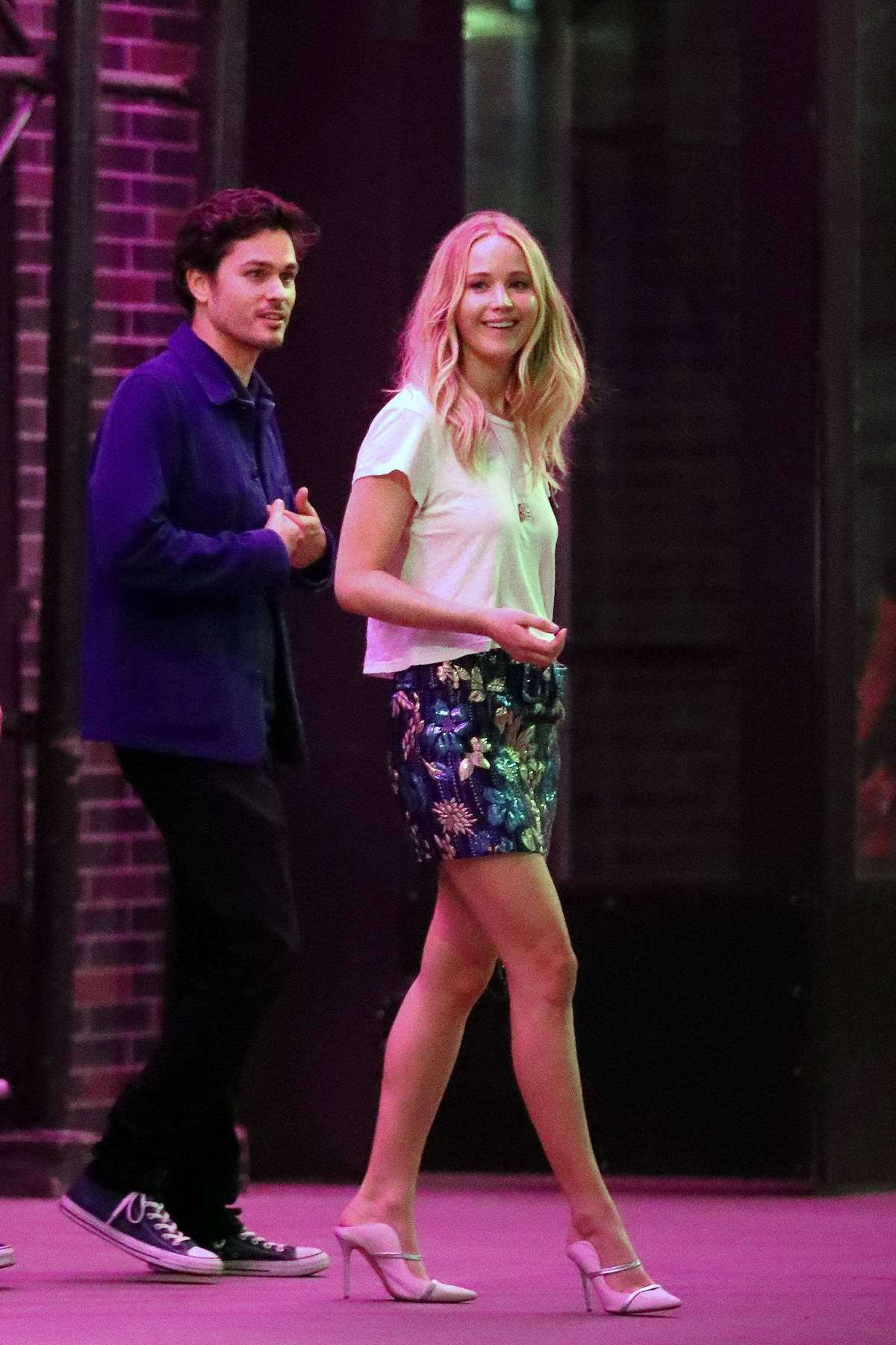 Jennifer Lawrence looks pretty in white top and floral mini skirt during a date night with Cooke Maroney in New York City