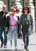 Jennifer Lopez dons colorful leggings and a cropped pink sweater as she heads to the gym with sister Linda in New York City