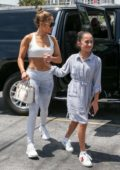 Jennifer Lopez flashes her abs in a white cropped tank top as she heads to the gym with her daughter and sister in Miami, Florida