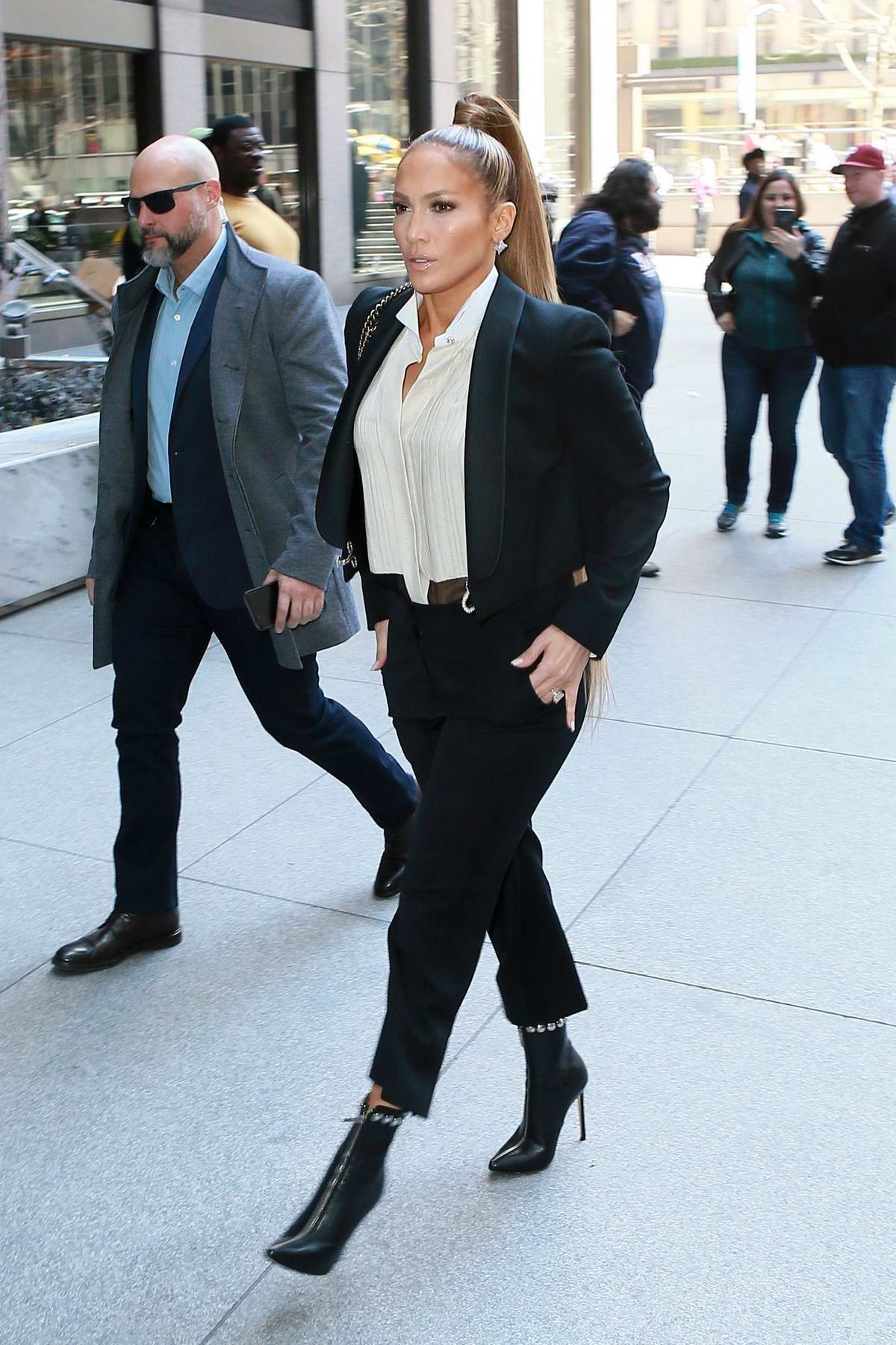 Jennifer Lopez wears a black suit as she heads to SiriusXM Radio in midtown Manhattan in New York City