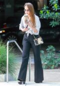 Jessica Alba chats on the phone before she heads to her office in Santa Monica, California
