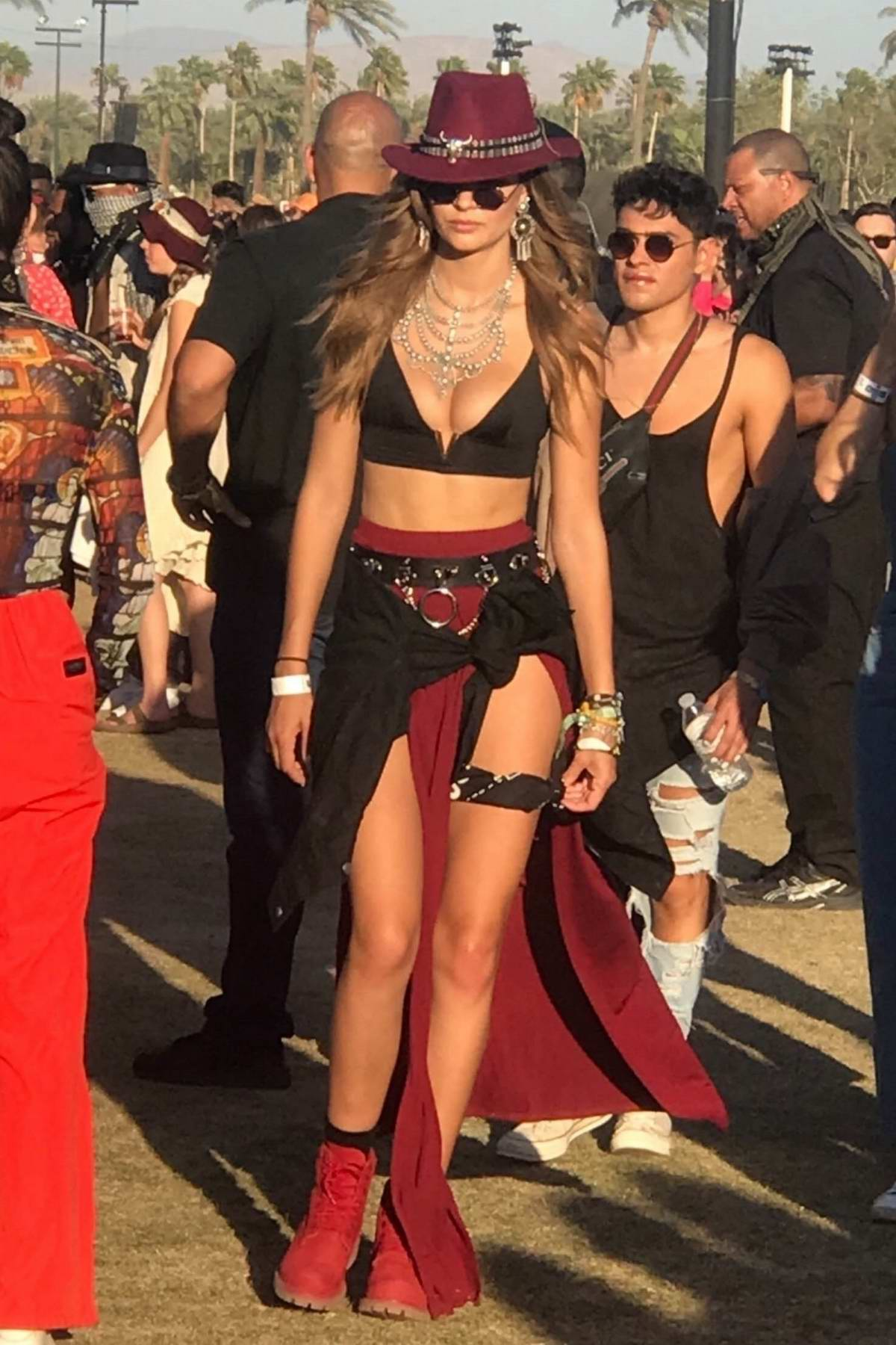 Josephine Skriver watches Bad Bunny and stops to take pictures with fans during Weekend 2 of Coachella in Indio, California