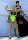 Joy Corrigan poses in a neon green bikini during a photoshoot in Mexico