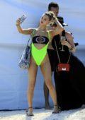 Joy Corrigan poses in a neon green bikini during a photoshoot in Mexico