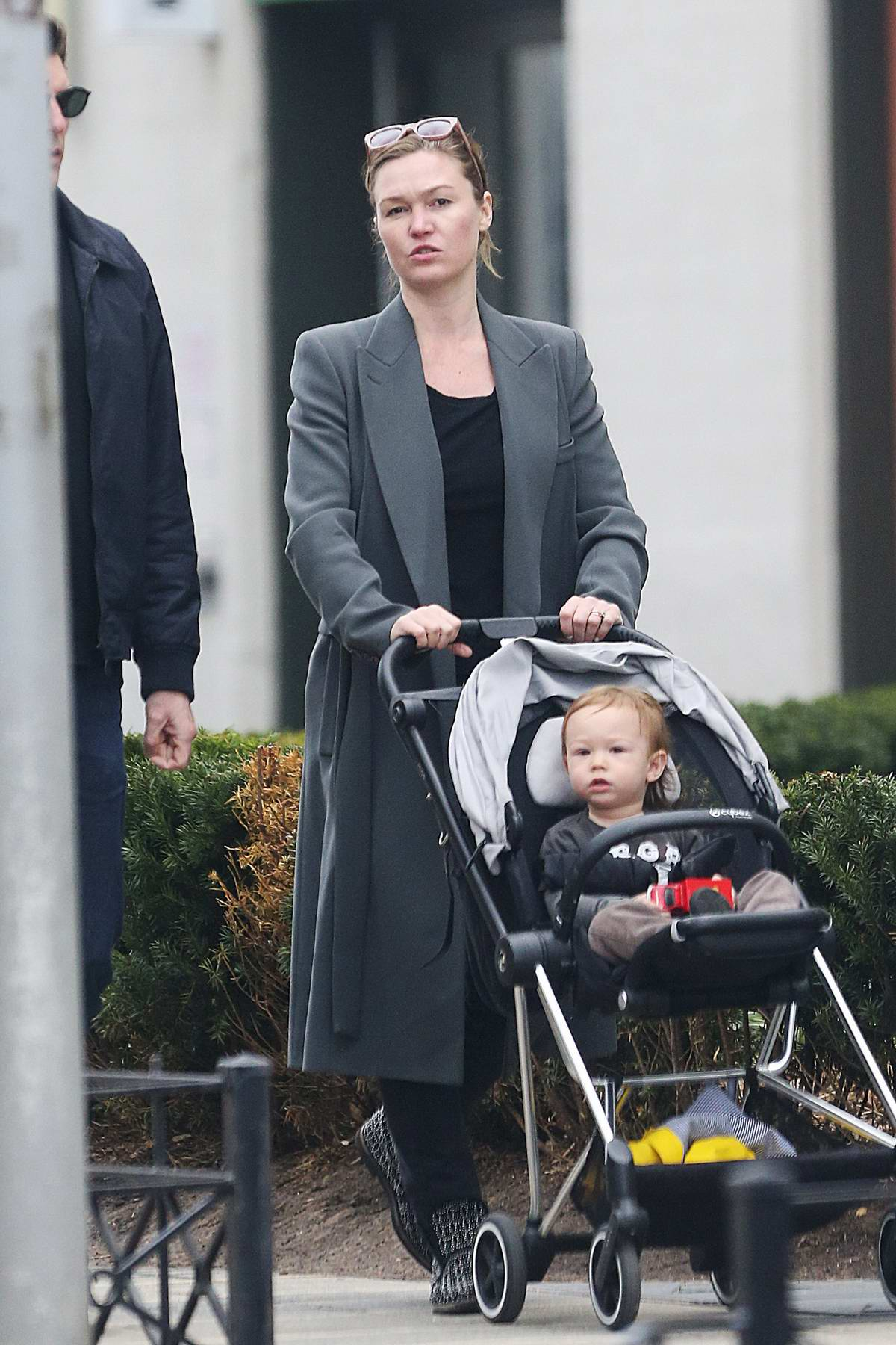 Julia Stiles takes her son for a stroll with a friend in Brooklyn, New York City