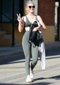 Julianne Hough is all smiles as she leaves the gym wearing an olive green sports bra with matching leggings in Studio City, Los Angeles