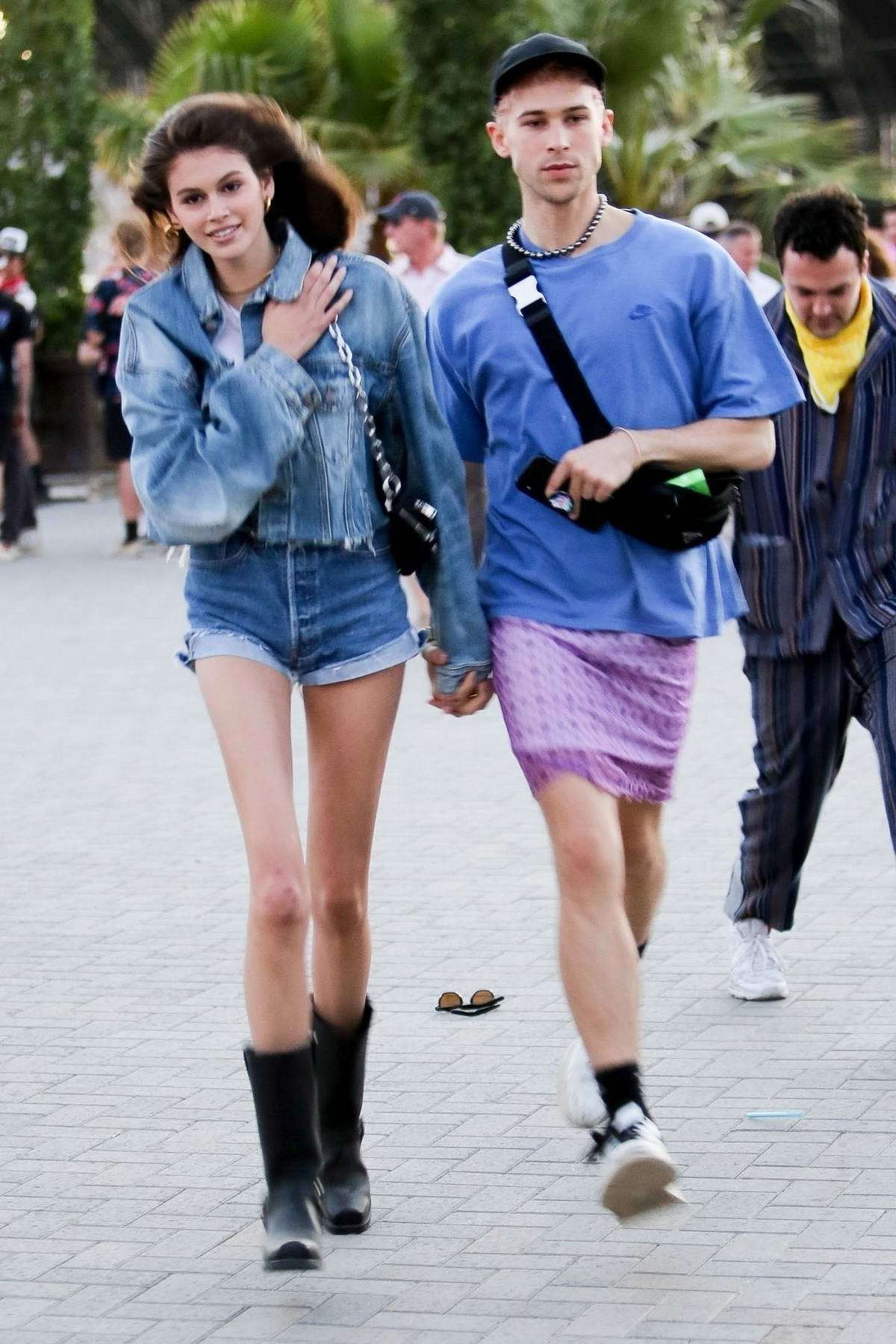 Kaia Gerber dons double denim while out and about with Tommy Dorfman at Coachella in Indio, California