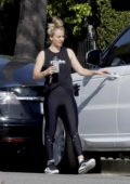 Kaley Cuoco looks fit in a black tank top with matching leggings and trainers as she leaves after a workout session in Los Angeles