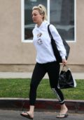Kaley Cuoco rocks a white hoodie, black leggings and flip-flops as she leaves after a pedicure session in Los Angeles