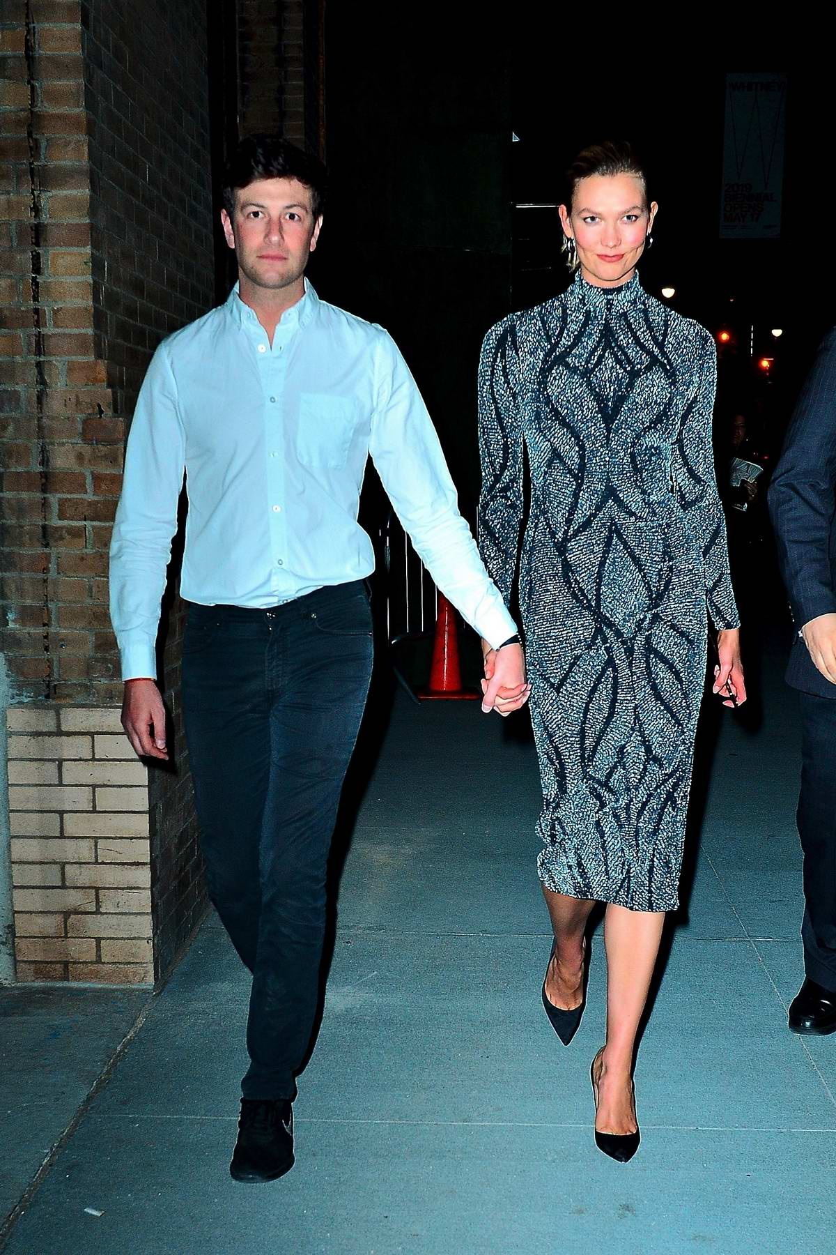 Karlie Kloss and Joshua Kushner are all smiles as they step out holding hands after the Project Runway event in New York City