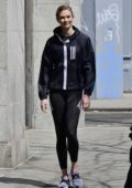 Karlie Kloss flashes a smile for the camera during an Adidas photoshoot in New York City
