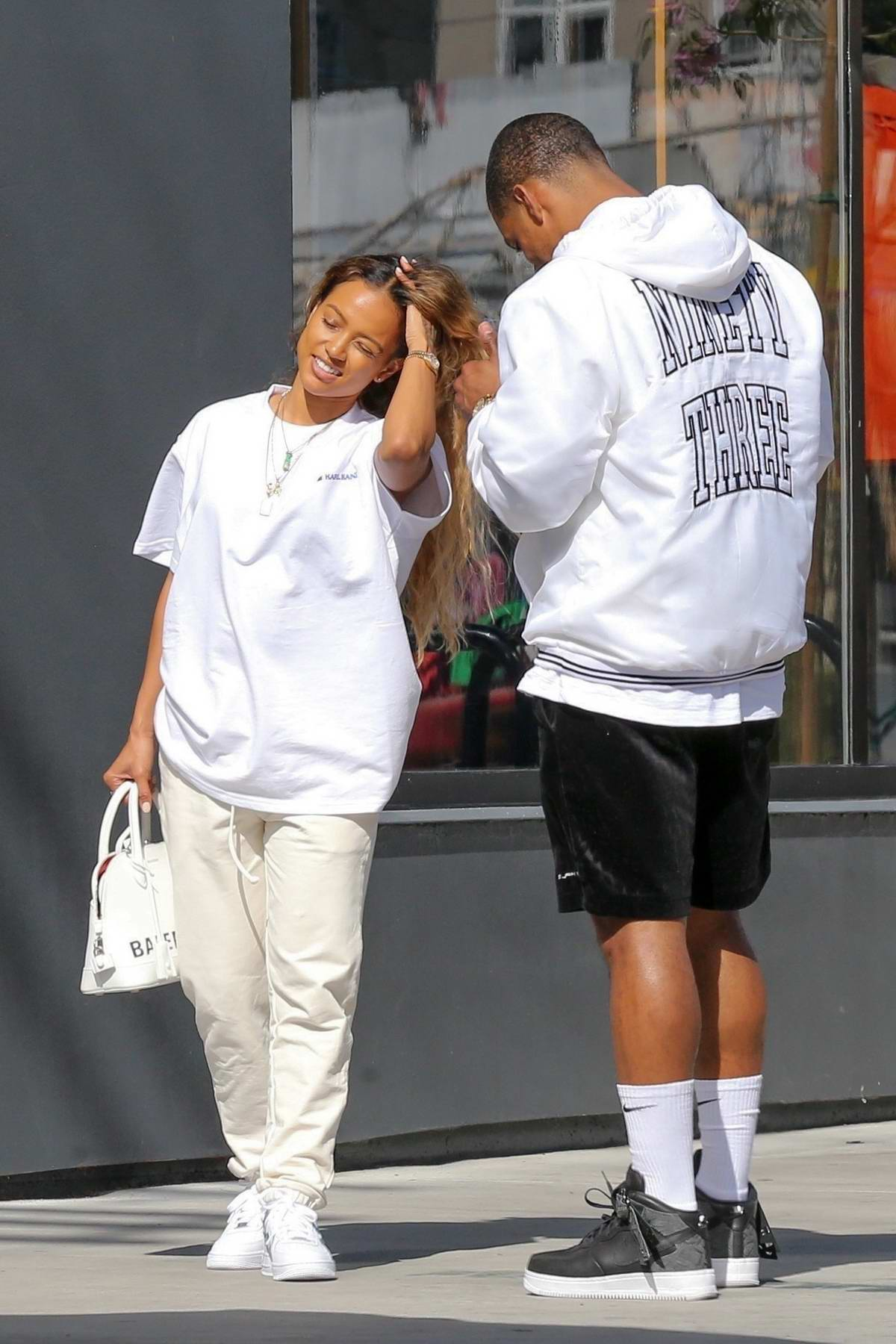 Karrueche Tran dons all white while out on a lunch date with Victor Cruz in in Los Angeles