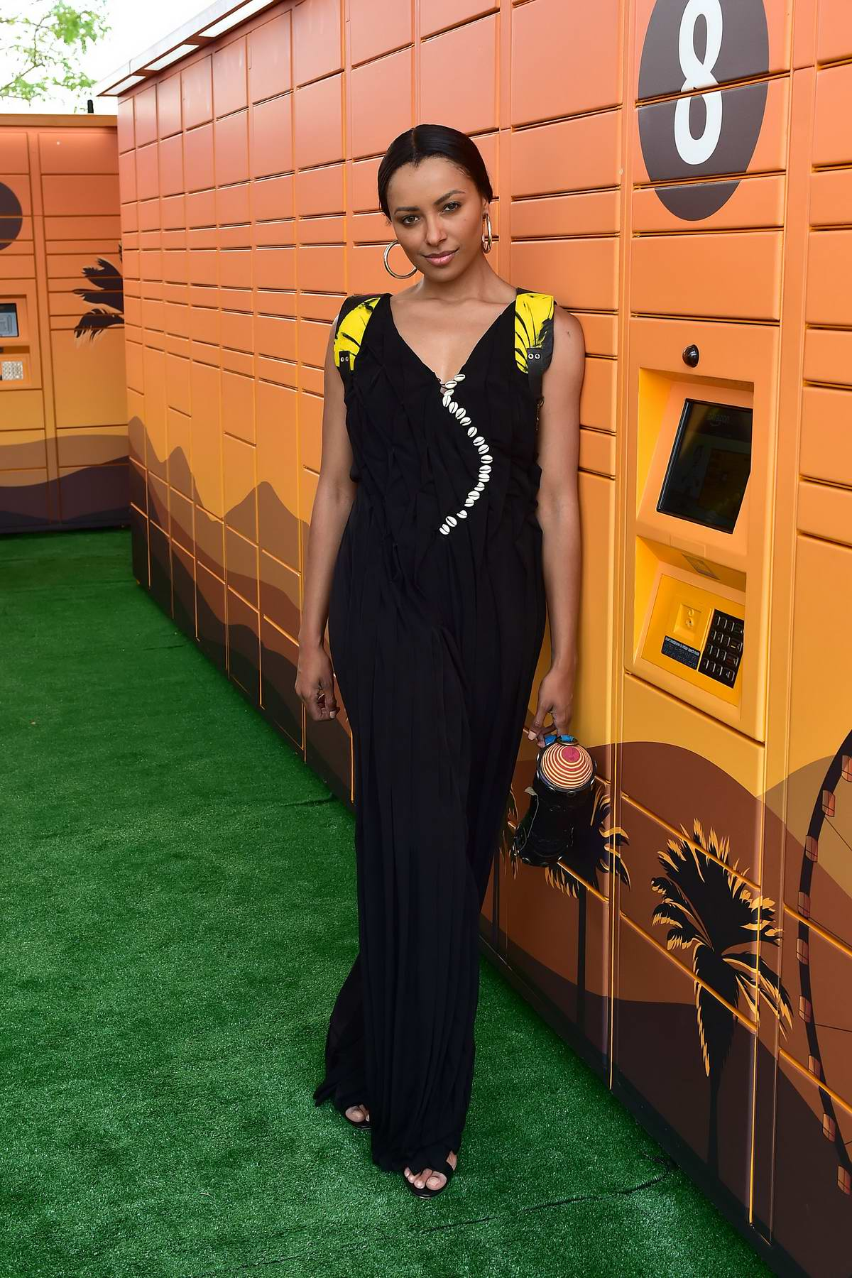 Kat Graham pose for photos at the Amazon Lockers during Coachella 2019, Weekend 2 in Indio, California
