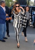 Kate Beckinsale looks striking in a black and white striped paintsuit as she returns to her hotel in New York City