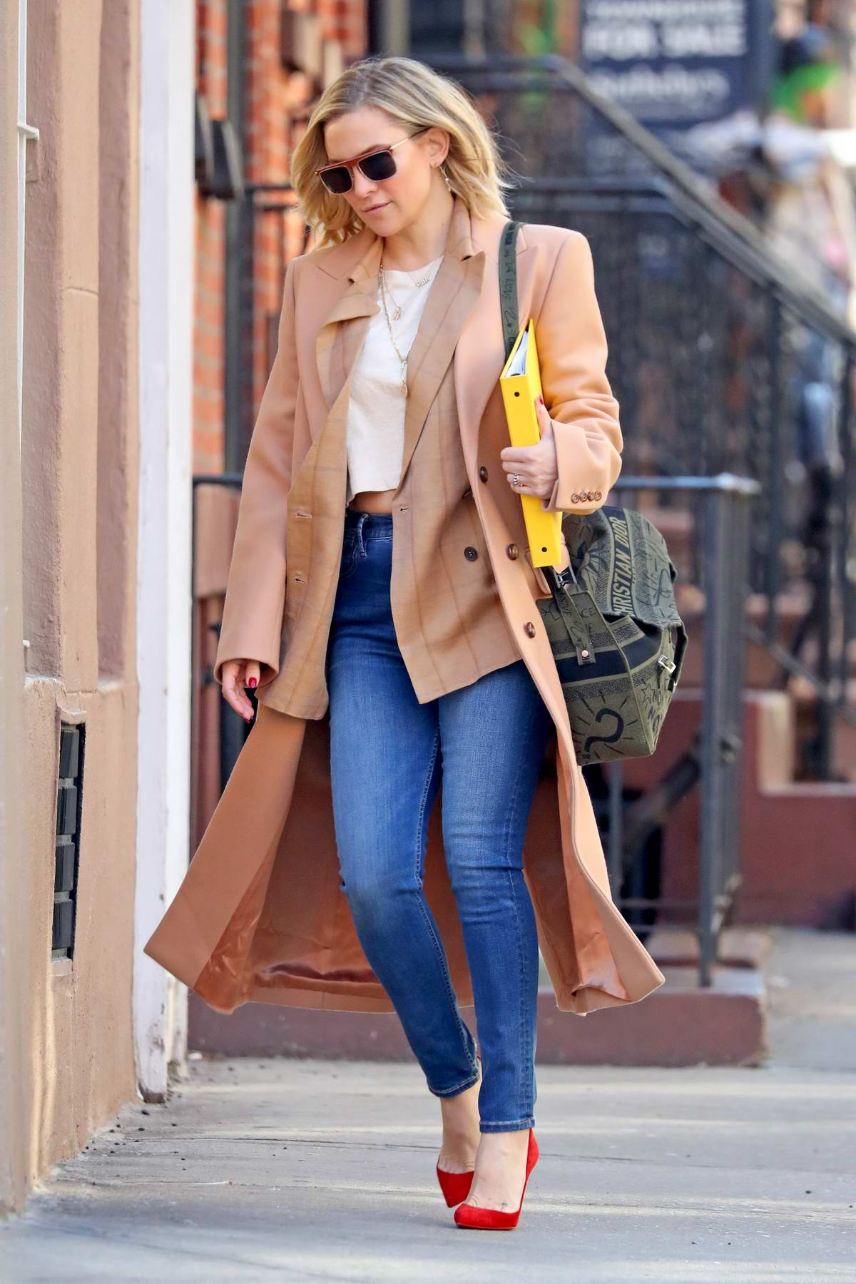 Kate Hudson looks stylish in a peach trench coat and jeans while out in New York City