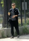 Kate Mara cradles her baby bump while out for a solo walk at a reservoir in Los Angeles