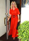 Katy Perry looks vibrant in a bright red ensemble while out for dinner at Madeo in Beverly Hills, Los Angeles