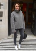 Keeley Hawes pose for photos and greet her fans as she leaves BBC Radio 2 Studios in London, UK